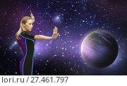 Купить «futuristic woman over planet and stars in space», фото № 27461797, снято 17 ноября 2012 г. (c) Syda Productions / Фотобанк Лори