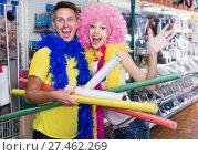 Купить «Couple with firecrackers in hands is grimacing on camera», фото № 27462269, снято 11 апреля 2017 г. (c) Яков Филимонов / Фотобанк Лори