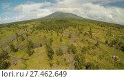 Купить «The foot of the Mayon Volcano with flowing mountain rivers near Legazpi city in Philippines. Aerial view Mayon Volcano is an active volcano and 2462 meters high.», видеоролик № 27462649, снято 23 января 2018 г. (c) Mikhail Davidovich / Фотобанк Лори