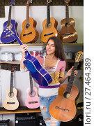 Купить «girl choosing acoustic guitar», фото № 27464389, снято 19 июля 2019 г. (c) Яков Филимонов / Фотобанк Лори