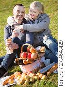 Купить «Loving pleasant young couple chatting as having picnic», фото № 27464429, снято 18 июля 2018 г. (c) Яков Филимонов / Фотобанк Лори