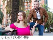 Купить «Young woman is inaccessibility when man is playful talking with her», фото № 27464489, снято 18 октября 2017 г. (c) Яков Филимонов / Фотобанк Лори