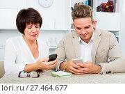 Купить «Mother and son with smartphones», фото № 27464677, снято 8 июля 2020 г. (c) Яков Филимонов / Фотобанк Лори
