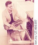 Купить «customer looking at dishwashers», фото № 27464697, снято 17 ноября 2019 г. (c) Яков Филимонов / Фотобанк Лори