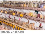 Купить «Big choice of glass cans with many different dried spices plants is standing on shelf», фото № 27467301, снято 13 июня 2017 г. (c) Яков Филимонов / Фотобанк Лори
