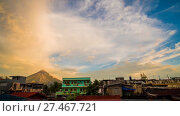 """Купить «Morning in Legazpi city near with Mayon Volcano is an active stratovolcano in the province of Albay in Bicol Region on the island of Luzon in the Philippines. Renowned as the """"perfect cone"""" because of its symmetric conical shape. TimeLapse in sunrise.», видеоролик № 27467721, снято 25 января 2018 г. (c) Mikhail Davidovich / Фотобанк Лори"""
