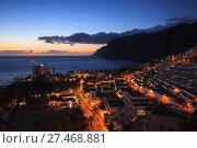 Купить «residential apartments in the background of Los Gigantes Cliffs, Tenerife, Spain», фото № 27468881, снято 29 апреля 2012 г. (c) Ирина Мойсеева / Фотобанк Лори