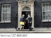 Купить «Theresa May and husband Philip May pose on the steps at 10 Downing Street after officially taking the office of Prime Minister Featuring: Theresa May,...», фото № 27469661, снято 13 июля 2016 г. (c) age Fotostock / Фотобанк Лори