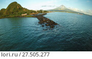 Купить «Aerial panorama of the city of Legaspi in the morning at dawn. Against the backdrop of the Mayon volcano. Seaport with boats.», видеоролик № 27505277, снято 27 января 2018 г. (c) Mikhail Davidovich / Фотобанк Лори