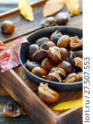 Roasted chestnuts in a cast iron skillet. Стоковое фото, фотограф Марина Сапрунова / Фотобанк Лори