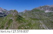 Купить «Aerial view on mountains in the park Durmitor», видеоролик № 27519837, снято 13 декабря 2017 г. (c) Михаил Коханчиков / Фотобанк Лори