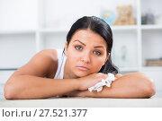 Купить «Sad brunette wipes tears», фото № 27521377, снято 18 февраля 2018 г. (c) Яков Филимонов / Фотобанк Лори