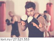 Купить «boxer trains in kickboxing gloves», фото № 27521553, снято 5 мая 2017 г. (c) Яков Филимонов / Фотобанк Лори