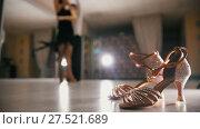 Купить «Blurred professional man and woman dancing Latin dance in costumes in the Studio, ballroom shoes in the foreground, slow motion», видеоролик № 27521689, снято 7 августа 2020 г. (c) Константин Шишкин / Фотобанк Лори