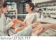 Купить «cheerful female manicurist filing and shaping nails in beauty salon», фото № 27521717, снято 28 апреля 2017 г. (c) Яков Филимонов / Фотобанк Лори