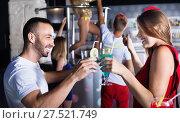 Купить «Female and male clubbing with cocktail in the club on party», фото № 27521749, снято 28 августа 2017 г. (c) Яков Филимонов / Фотобанк Лори