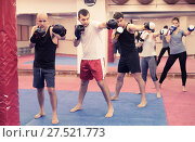 Купить «People of different ages training at kickboxing», фото № 27521773, снято 5 мая 2017 г. (c) Яков Филимонов / Фотобанк Лори