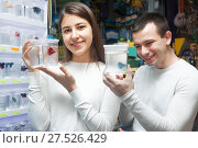 Купить «couple selecting tropical fish», фото № 27526429, снято 17 августа 2018 г. (c) Татьяна Яцевич / Фотобанк Лори