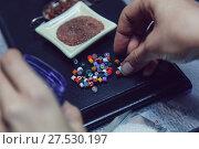 Купить «Process of manufacturing costume jewelery from Venetian glass.», фото № 27530197, снято 10 января 2018 г. (c) Женя Канашкин / Фотобанк Лори