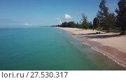 Купить «Aerial of beauty deserted beach and calm sea», видеоролик № 27530317, снято 21 января 2018 г. (c) Михаил Коханчиков / Фотобанк Лори