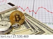 Купить «Золотая монета Bitcoin. Доллары, графики, калькулятор и секундомер», эксклюзивное фото № 27530469, снято 30 января 2018 г. (c) Юрий Морозов / Фотобанк Лори