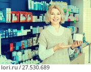 Купить «Female customer in pharmacy drugstore», фото № 27530689, снято 16 августа 2018 г. (c) Яков Филимонов / Фотобанк Лори