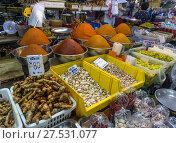 Купить «Spices, roots and herbs on the counter», фото № 27531077, снято 10 января 2017 г. (c) Михаил Коханчиков / Фотобанк Лори