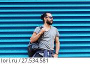 Купить «man in sunglasses with bag standing at street wall», фото № 27534581, снято 2 июня 2016 г. (c) Syda Productions / Фотобанк Лори