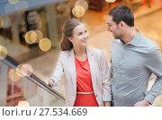 Купить «happy young couple with shopping bags in mall», фото № 27534669, снято 10 ноября 2014 г. (c) Syda Productions / Фотобанк Лори