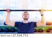 Купить «man exercising on bar and doing pull-ups in gym», фото № 27534713, снято 19 февраля 2017 г. (c) Syda Productions / Фотобанк Лори