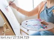Купить «artist with palette and brush painting at studio», фото № 27534729, снято 1 июня 2017 г. (c) Syda Productions / Фотобанк Лори