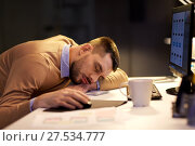 Купить «tired man sleeping on table at night office», фото № 27534777, снято 26 ноября 2017 г. (c) Syda Productions / Фотобанк Лори