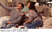 Купить «happy couple taking selfie by smartphone at home», видеоролик № 27535929, снято 23 января 2018 г. (c) Syda Productions / Фотобанк Лори