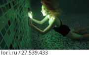 Купить «Beautiful girl swim underwater into night waterpool with lights», видеоролик № 27539433, снято 1 февраля 2018 г. (c) katalinks / Фотобанк Лори