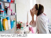 Купить «woman in the bathroom yawns», фото № 27546221, снято 12 декабря 2017 г. (c) Типляшина Евгения / Фотобанк Лори