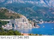 RAFAILOVICHI, MONTENEGRO - JULY 13, 2015: Coastal town Rafailovici, Budvanska Riviera, Montenegro. Adriatic resort with beach and sea. Редакционное фото, фотограф Papoyan Irina / Фотобанк Лори