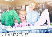 Купить «Two happy sisters during family shopping», фото № 27547477, снято 27 декабря 2017 г. (c) Яков Филимонов / Фотобанк Лори