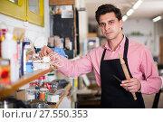 Купить «Joiner looking for necessary tools», фото № 27550353, снято 8 апреля 2017 г. (c) Яков Филимонов / Фотобанк Лори