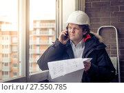 Купить «Construction Engineer Using Cell Mobile Phone. Soft focus, toned.», фото № 27550785, снято 17 июля 2018 г. (c) Marina Sharova / Фотобанк Лори