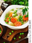 Купить «Chicken soup with green peas», фото № 27562681, снято 21 декабря 2017 г. (c) Надежда Мишкова / Фотобанк Лори