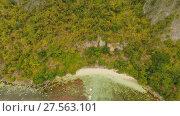 Купить «Aerial view Sunset and Atwayan beach with rocks. Travelling tour in Asia: Palawan, Philippines.», видеоролик № 27563101, снято 4 февраля 2018 г. (c) Mikhail Davidovich / Фотобанк Лори