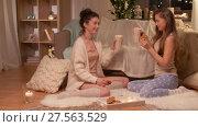 Купить «happy female friends at home pajama party», видеоролик № 27563529, снято 25 января 2018 г. (c) Syda Productions / Фотобанк Лори