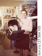 Купить «female choosing infant's car cradle», фото № 27564105, снято 19 декабря 2017 г. (c) Яков Филимонов / Фотобанк Лори