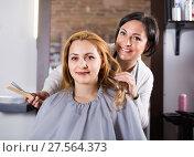 Купить «Woman very much likes her fashionable hairdress in hairdressing salon», фото № 27564373, снято 7 марта 2017 г. (c) Яков Филимонов / Фотобанк Лори