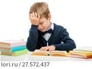 Купить «schoolboy at the table reading a book, shooting on a white background», фото № 27572437, снято 9 сентября 2017 г. (c) Константин Лабунский / Фотобанк Лори