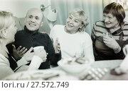Купить «Mature friends are talking about life and drinking tea», фото № 27572749, снято 16 декабря 2017 г. (c) Яков Филимонов / Фотобанк Лори