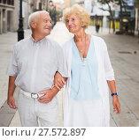 Купить «loving mature spouses enjoying walk», фото № 27572897, снято 27 августа 2017 г. (c) Яков Филимонов / Фотобанк Лори