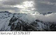 Купить «Flying through clouds between mountains», видеоролик № 27579977, снято 6 июня 2017 г. (c) Михаил Коханчиков / Фотобанк Лори