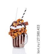 Chocolate indulgent extreme milkshake with chocolate, popcorn and sweets. Crazy freakshake food trend. Isolate. Стоковое фото, фотограф Евгений Глазунов / Фотобанк Лори