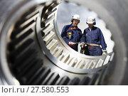 Купить «industry workers seen through a large cogwheels axle», фото № 27580553, снято 26 марта 2019 г. (c) PantherMedia / Фотобанк Лори